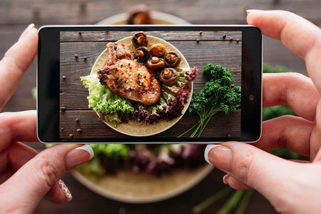 Taking a Photo of a Pork Dish With a Smart Phone.