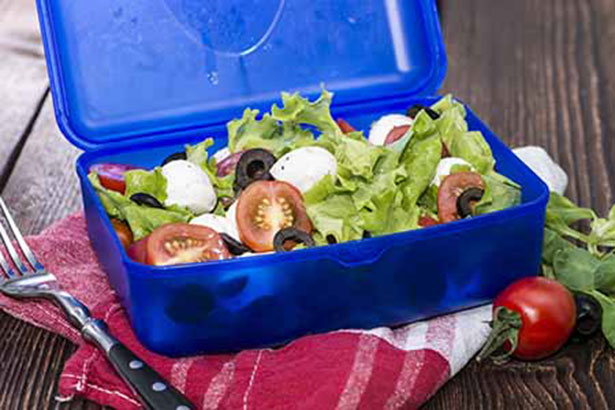 Healthy low carb lunchbox with a fresh cheese and tomato salad