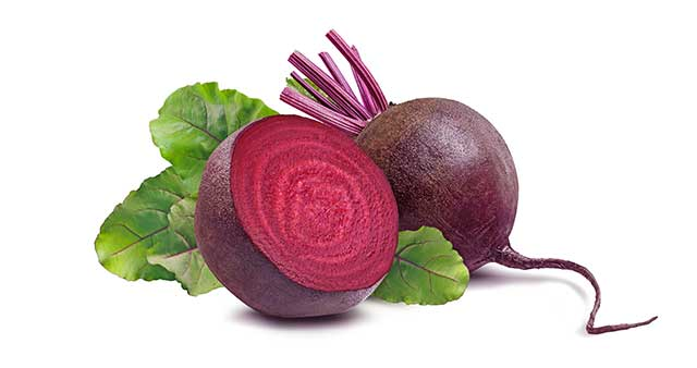 Whole Beet Root and Half Beet Root Next To Each Other.