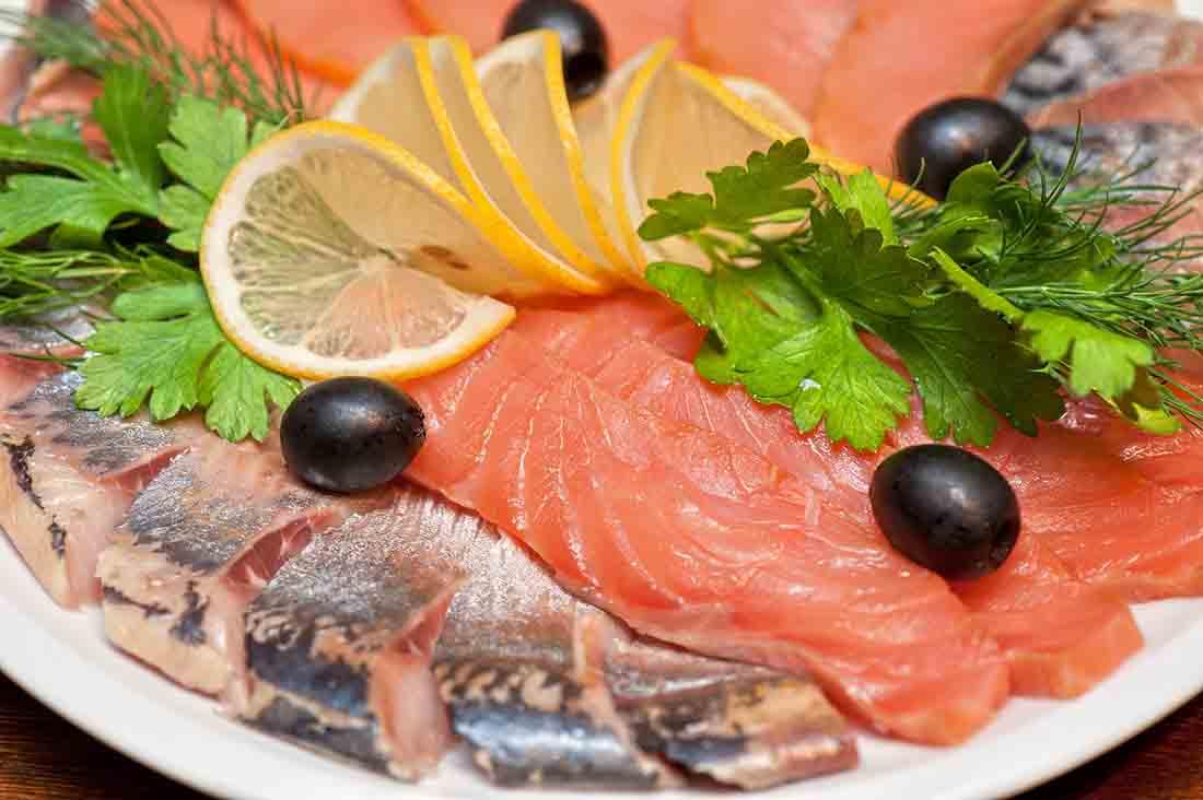 Fresh Raw Salmon With Lemon Slices and Leaf Decoration.