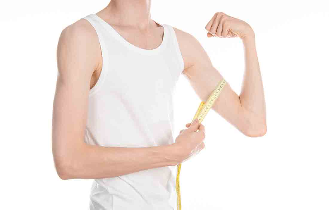 A Skinny Man Measuring the Size of His biceps.