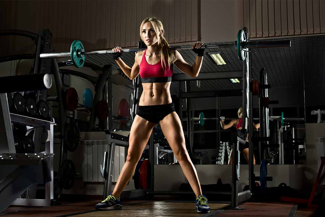 An Athletic Female Doing Body Squats With a Realistic Weight.