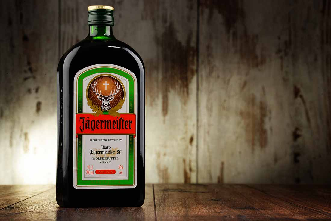 A Bottle of Jagermeister on a Wooden Surface.