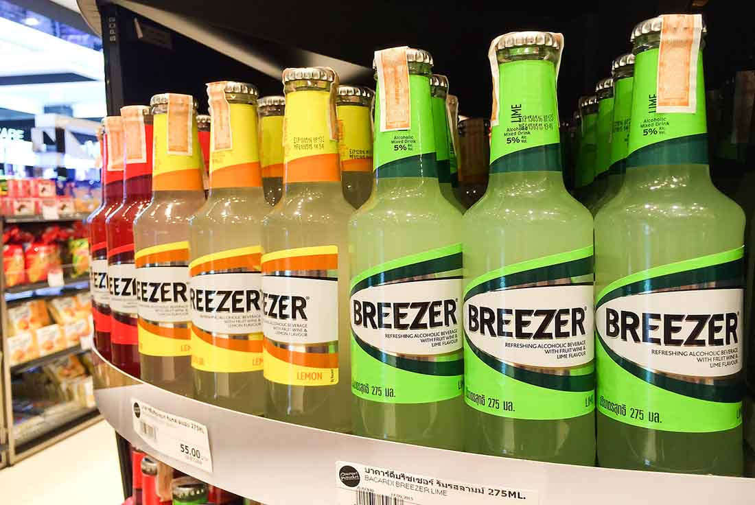Various Alcopops On a Store Shelf.