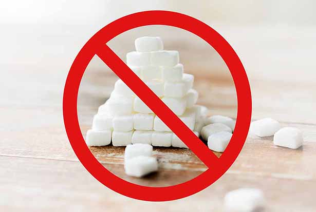 Picture of Sugar Cubes Behind a Red Prohibited Sign.