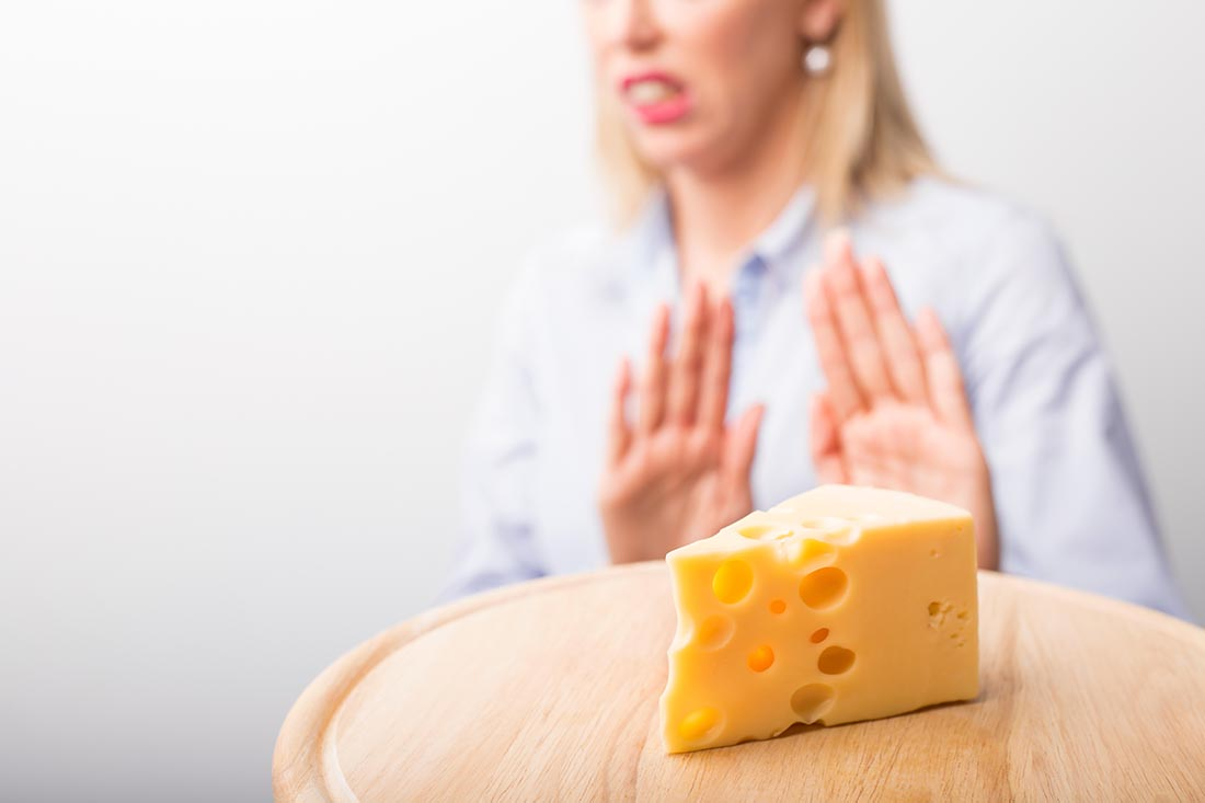 A Lady Rejecting the Chance To Eat a Piece of Cheese.