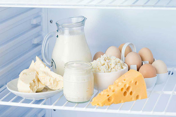 Various Dairy Products In a Refrigerator - Milk, Cream, Cheese, Cream Cheese.