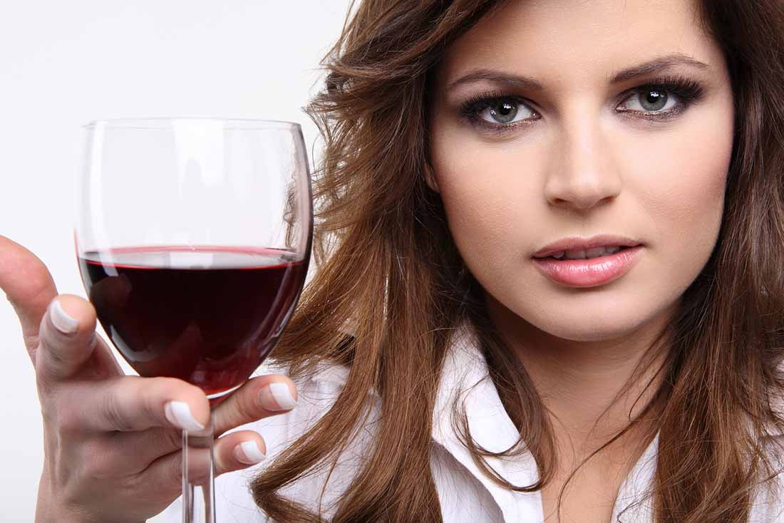 A Lady Holding a Glass of Red Wine.