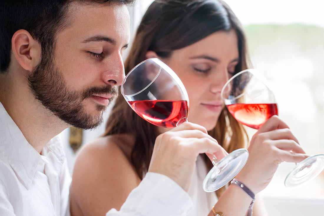 A Young Couple Drinking a Glass of Rose Wine.