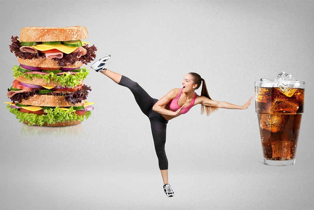 An Athletic Woman High-Kicking Junk Food.