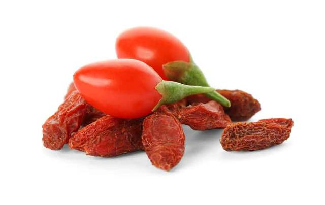 Fresh and Dried Goji Berries Next To Each Other.