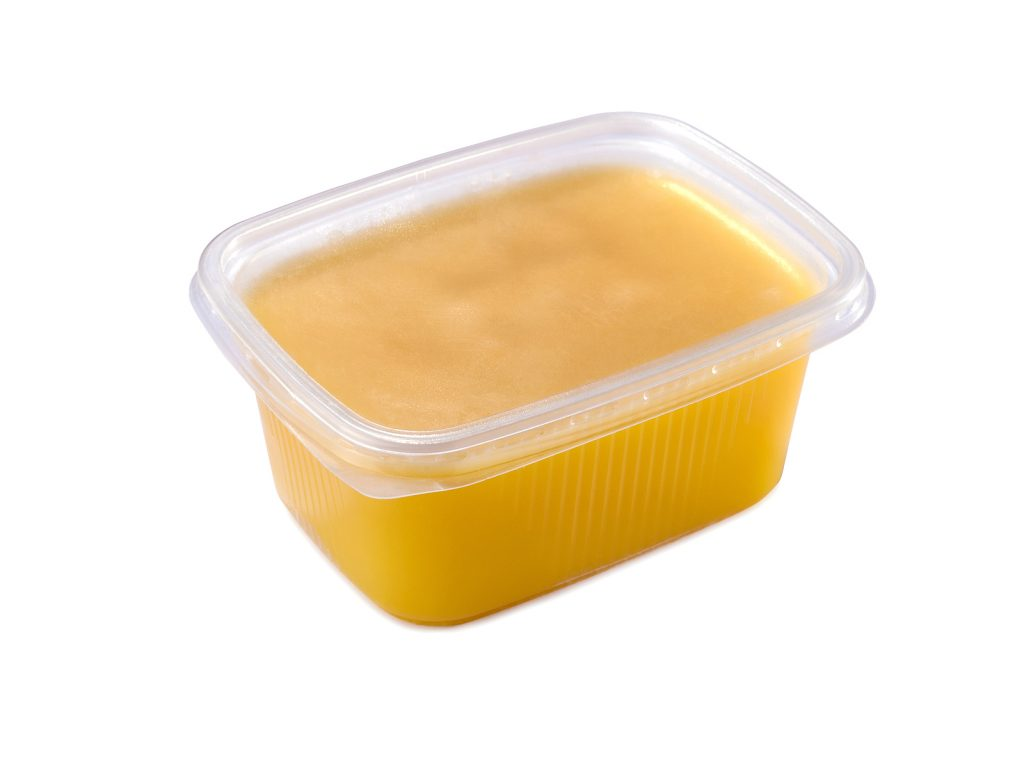 A picture of ghee in a plastic tub.