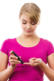 Picture of a Girl Taking Blood Test on a Glucometer