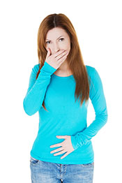 Picture of a woman feeling ill - stomach or digestion issues.