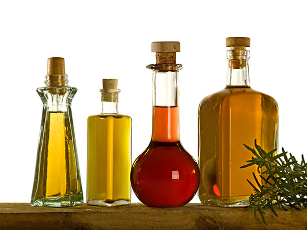 Various Cooking Oils In Glass Bottles.