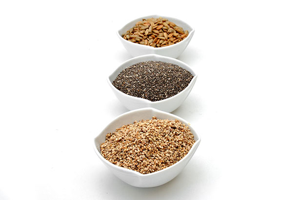 Various Edible Seeds In White Bowls - Includes Chia and Flaxseed.