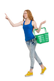Picture of a Young Lady Shopping With a Green Basket.