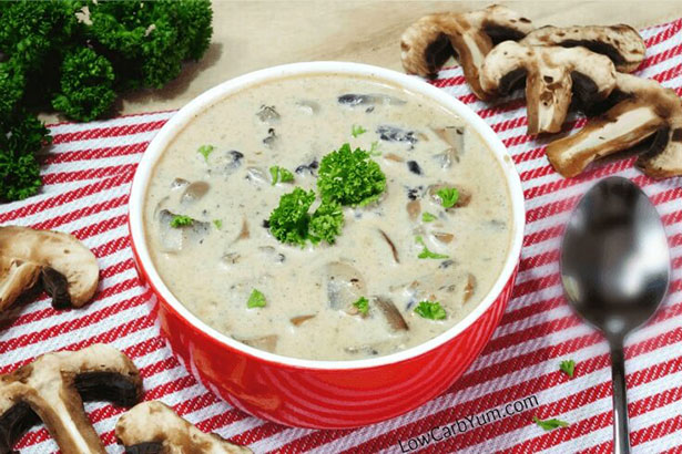A Keto-Friendly Cream of Mushroom Soup In a Red Bowl.
