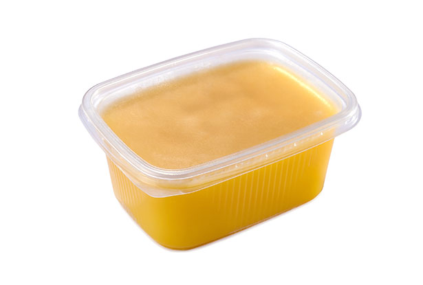A Tub of Golden Colored Ghee.