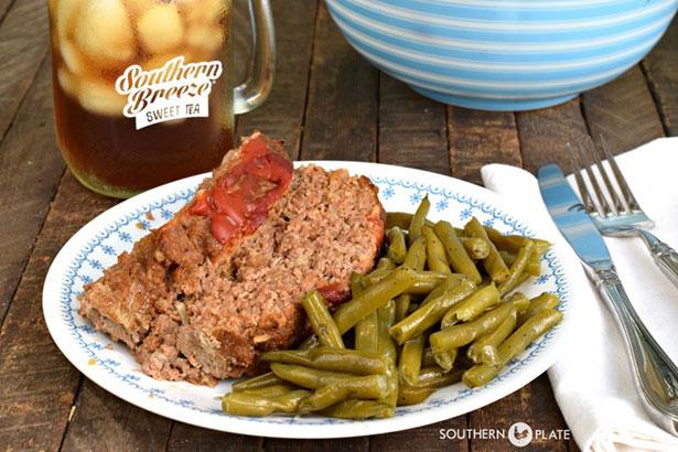 A Plate of Meatloaf Served Alongside Green Beans.