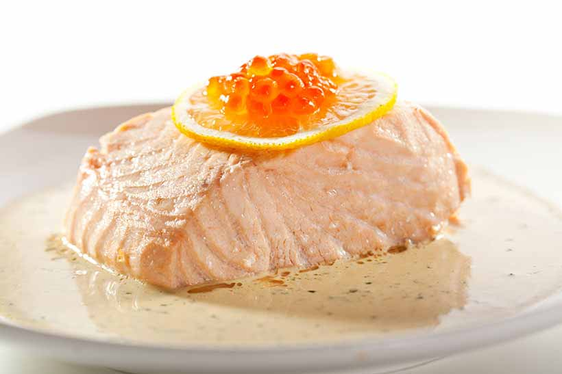 Poached Salmon In a Cream Sauce and Topped With Fish Roe.