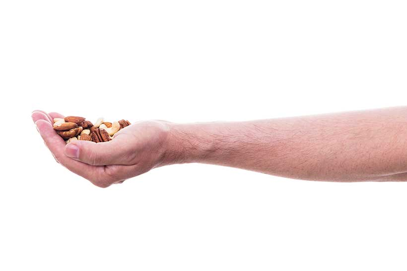 A Man Holding a Handful of Mixed Nuts