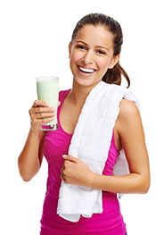 A Woman Drinking a Protein Shake.