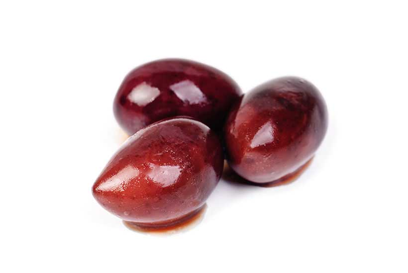 Three Kalamata Olives on a White Background.