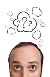 Picture of a Man Thinking With a Question Mark Sign.