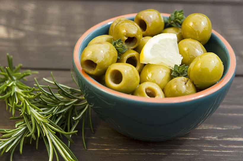 Manzanilla Pitted Olives in a Bowl Waiting on the Table.