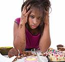 A Girl Feeling Guilty After Bingeing on Junk Food.