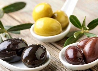 Three Types of Olives on a Table.