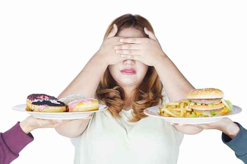 Girl Trying to Lose Weight is Tempted by Junk Food.