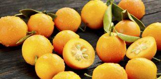 Many Kumquat Fruit On a Black Surface.