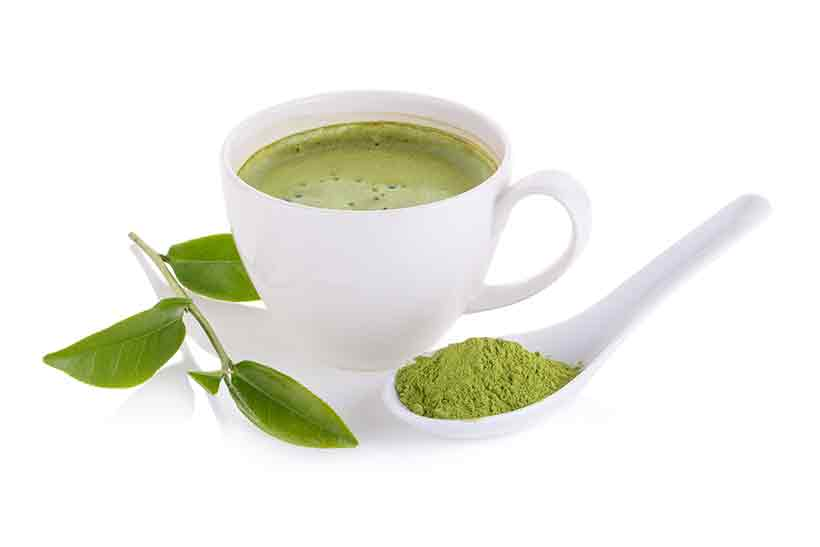 Freshly Brewed Japanese Matcha Green Tea, With Spoon and Powder.