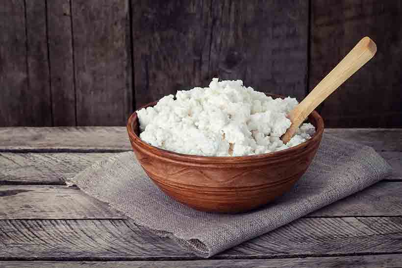 Fermented Cottage Cheese In a Brown Ceramic Bowl.