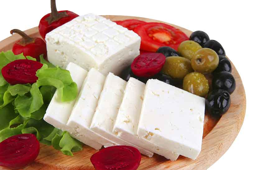 Feta Cheese On a Wooden Platter With Olives.