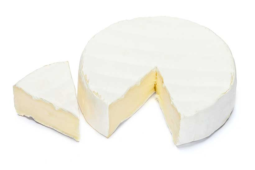 Round Portion of Brie Cheese Next To One Portion.