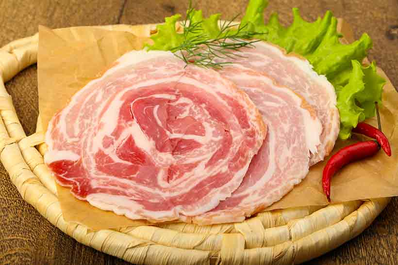 Slices of Pancetta Cured Meat.