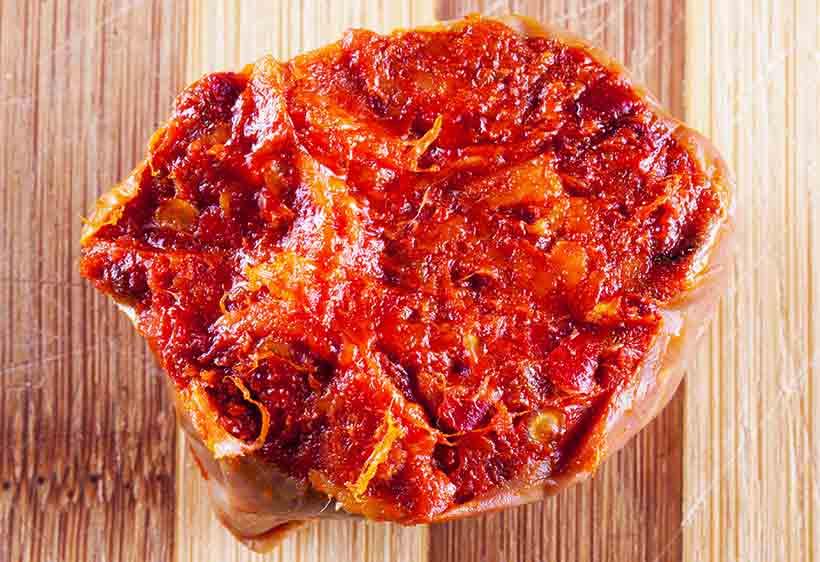 Spreadable Nduja Meat On a Wooden Board.