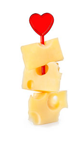 Several Pieces of Cheese Including Cheddar On a 'Kebab' Stick With Heart on Top.