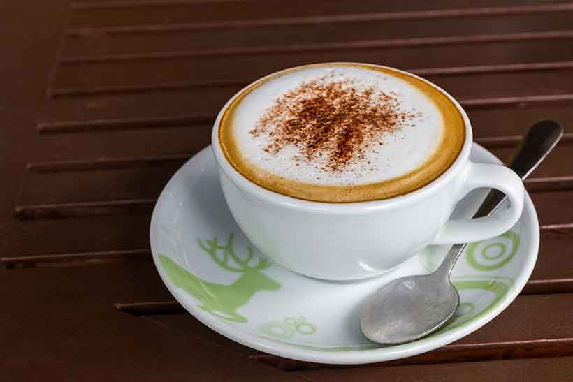 A Cup of Cocoa Butter Cafe Mocha On a Saucer.