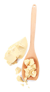 Picture of Cocoa Butter Chunks On a Wooden Spoon.