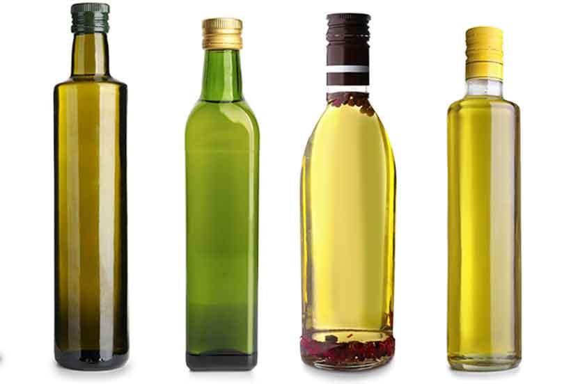 Bottles of Different Olive Oils: Extra Virgin vs Refined Olive Oils.