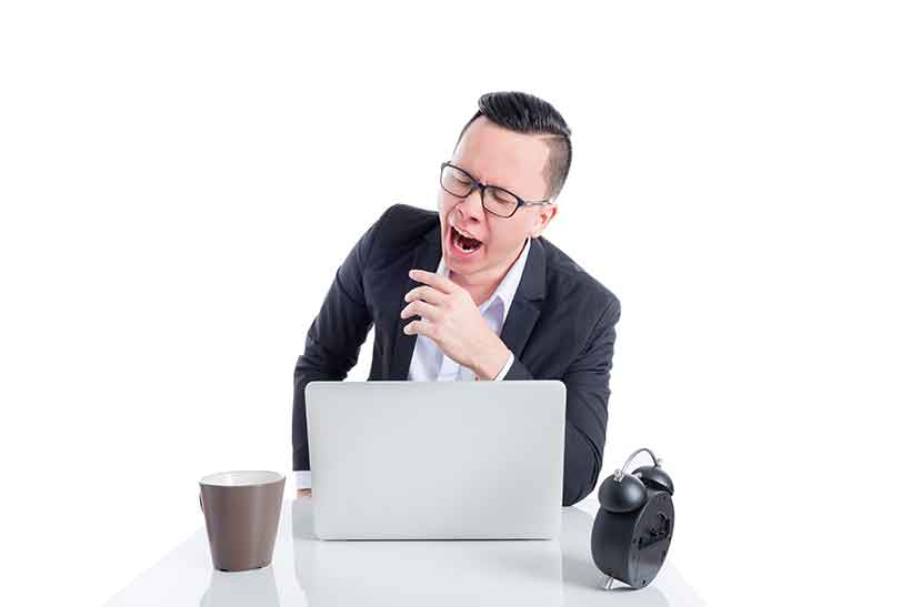 A Businessman Feeling Fatigued At His Desk.