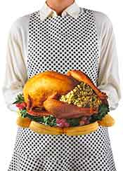 A Woman Serving Roast Turkey With Stuffing On a Plate.