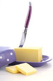 One Stick of Butter In a Butter Dish With a Knife.