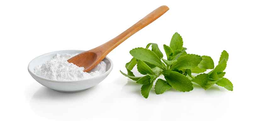 Stevia Leaves and Refined Stevia Powder In a Bowl.