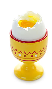 A Soft Boiled Egg In An Egg Cup With a Runny Yolk.