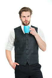 A Businessman Drinking a Cup of Black Tea, Looking Focused.
